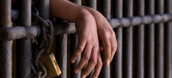 hands behind bars